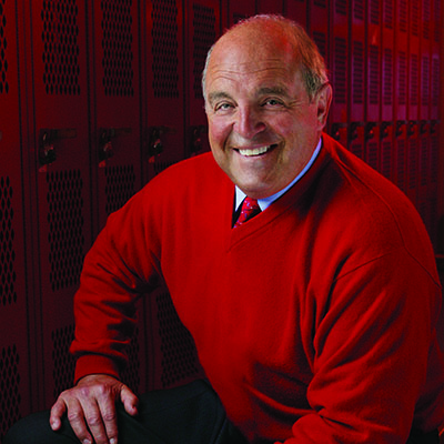 Alvarez's Headshot in Wisconsin red sweater