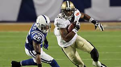 Colston, a Saints player, running away from opposing team