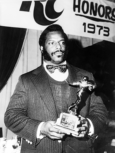 Dr. Thomas holding a trophy in 1973