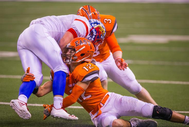 Columbus East's Jonah Wichman Julian Greenwell make a tackle in the 5A championship vs. Kokomo